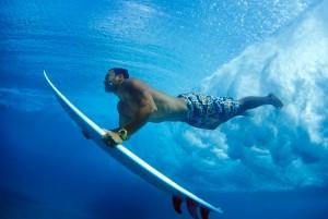 Sunny Garcia duckdiving under wave at Pipeline, 2000
